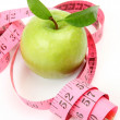 Foto Stock: Green apple and measuring tape