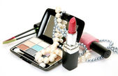 Decorative cosmetics and pearls — Stock Photo