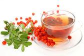 Tea in a mug and berries — Stock Photo