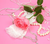 Pink rose and wedding accessories — Stock Photo