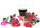 Wine and pink roses — Stock Photo