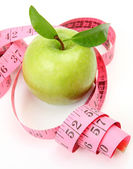 Green apple and measuring tape — Stok fotoğraf