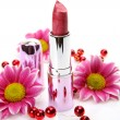 Stock Photo: Pink lipstick and flowers