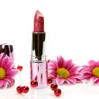 Pink lipstick and flowers — Stock Photo