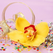 Yellow orchid and tape — Stock Photo
