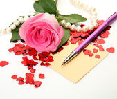 Roses petals and greeting card — Stock Photo
