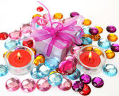 Box with a gift and candles — Stock Photo