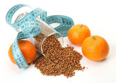 Buckwheat and tangerines — Stock Photo