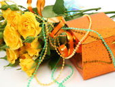 Roses and gifts — Stock Photo