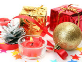 New Year's ornaments and candle — Stock Photo