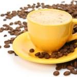 Coffee in a yellow mug — Stock Photo