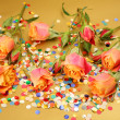 Stock Photo: Roses and confetti