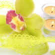 Orchid and candles — Stock Photo