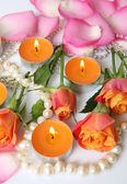 Roses and burning candles — Stock Photo