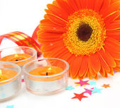 Flower and burning candles — Stock Photo