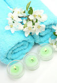 Towel and candles — Stock Photo