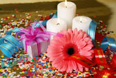 Gift and candles — Stock Photo