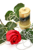 Candle and a rose — Stock Photo