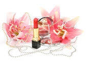 Dekorativní kosmetiky a květiny — Stock fotografie