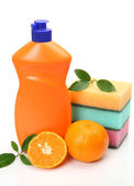 Bottle and orange — Stock Photo