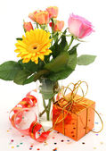 Fine roses and gift — Stock Photo