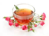 Tea and pink roses — Stock Photo