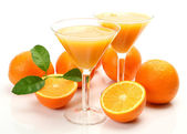 Fresh oranges and juice in glass — Stock Photo