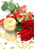 Roses and a candle — Stockfoto
