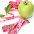 Green apple and measuring tape — Stock Photo