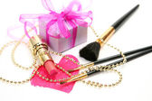 Decorative cosmetics and gift — Stock Photo