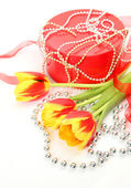 Fine tulips and gift — Stock Photo