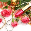 Decorative cosmetics and pink roses — Stock Photo #43588387