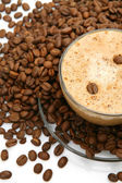 Coffee grains and cup — Stock Photo