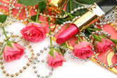Decorative cosmetics and pink roses — Stock Photo