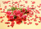Pink roses and confetti — Stock Photo