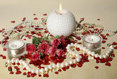 Candles and roses — Stock Photo