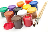 Paints and a brush — Stock Photo