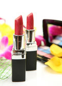 Pink orchid and lipstick — Stock Photo
