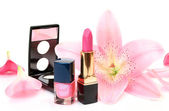 Petals of pink lilies and lipstick — Stock Photo