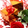 Box with a gift and rose — Stock Photo #45615909
