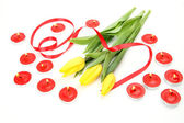 Yellow tulips and candles  — Stock Photo