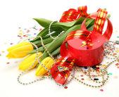 Yellow tulips and gift — Stock Photo