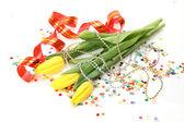 Yellow tulips and streamer — Stock Photo