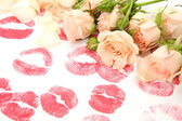Bouquet of roses and print of lips — Stock Photo