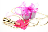 Lipstick and gift — Stock Photo