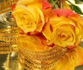 Yellow roses and tape — Stock Photo