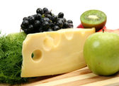 Fresh cheese and fruit — Stock Photo