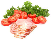 The cut ham and vegetables — Stock Photo
