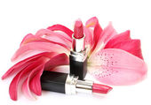 Petals and decorative cosmetics — Стоковое фото