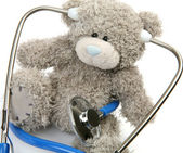 Toy and stethoscope — Stockfoto